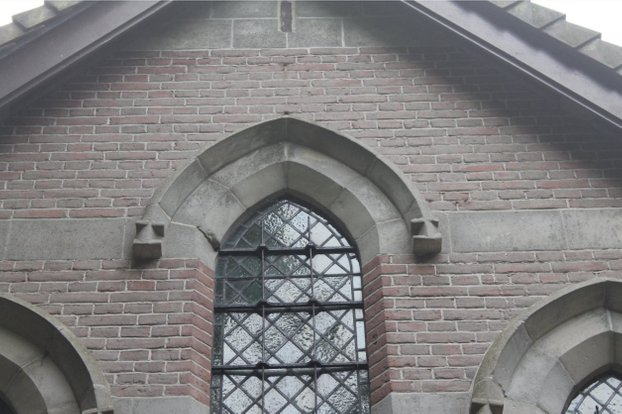 Sand stone pointed arch inset .